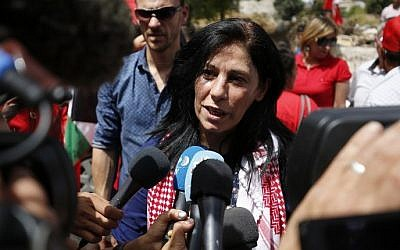 Prominent Palestinian lawmaker Khalida Jarrar greets speaks to reporters in her hometown, the West Bank city of Ramallah, following her release from an Israeli jail on June 3, 2016. (Abbas Momani/AFP/File)