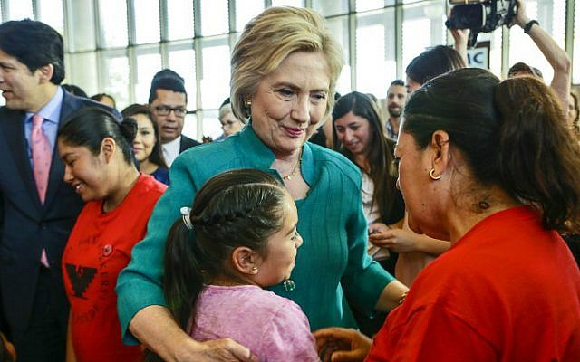 Democratic presidential candidate Hillary Clinton talks to undocumented farm worker Maria Licea, 49, and her 9-year-old daughter Jasmin Aguilar after a conversation on immigration held at Culinary Arts Institute of Los Angeles Mission College on June 4, 2016 in Sylmar, California. (Irfan Khan/Pool/AFP)