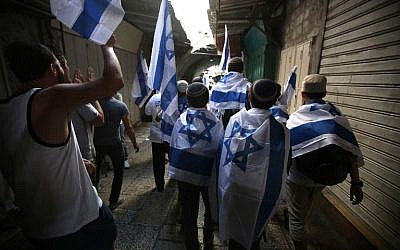 Young Jewish Israelis march through the Muslim Quarter of the Old City on their way to the Western Wall to celebrate Jerusalem Day on June 05, 2016. (Menahem Kahana/AFP)