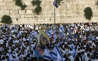 Israelis gather at the Western Wall in Jerusalem's Old City on June 5, 2016 with flags to celebrate Jerusalem Day, which marks Israel's victory in the 1967 Six Day War. (Menahem Kahana/AFP)