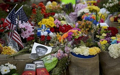 Flowers and memorabilia are seen at a memorial for boxing legend Muhammad Ali at the Mohammad Ali Center June 6, 2016 in Louisville, Kentucky. (AFP/ Brendan Smialowski)