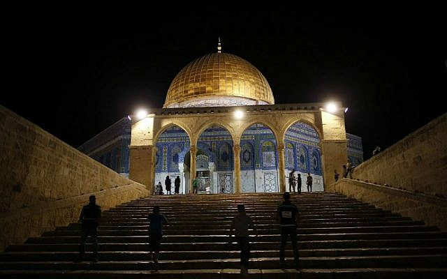 "Palestinian walk past the Dome of the Rock in the al-Aqsa Mosque compound on Jerusalem's Temple Mount during the ""tarawih"" prayer marking the first evening of Islam's holy month of Ramadan, on June 6, 2016. (Ahmad Gharabli/AFP)"