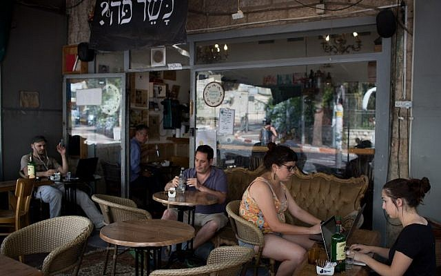 Customers sit at the Carousela restaurant, which was supervised by Hashgaha Pratit - Hebrew for private supervision - to check it abides by kosher practices, on June 8, 2016, in Jerusalem's Rehavia neighborhood.(AFP PHOTO / MENAHEM KAHANA)