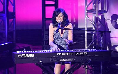 "This photo taken on April 20, 2016 shows singer Christina Grimmie performing at What's Trending's Fourth Annual Tubeathon Benefitting the American Red Cross on April 20, 2016 in Burbank. Grimmie, who starred in NBC's ""The Voice"", was shot and killed at a concert in Orlando, Florida late June 10 by an unidentified gunman, who then fatally shot himself, police said. (AFP PHOTO / GETTY IMAGES NORTH AMERICA / Viven Killilea)"