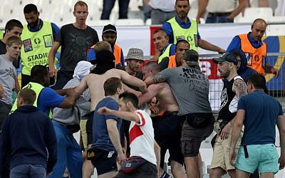 Groups of supporters clash fight at the end of the Euro 2016 group B football match between England and Russia at the Stade Velodrome in Marseille on June 11, 2016. (AFP Photo/Valery Hache)