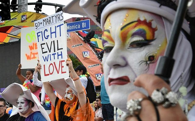 Participants show their support for victims of the Orlando shooting during the 2016 Gay Pride Parade on June 12, 2016 in Los Angeles, California. (Mark Ralston/AFP)