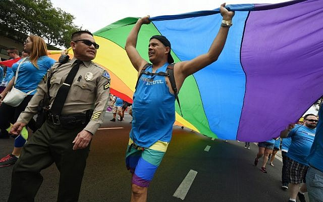 Sheriff's deputies provide security during the 2016 Gay Pride Parade on June 12, 20116 in Los Angeles, California.(AFP PHOTO / Mark Ralston)
