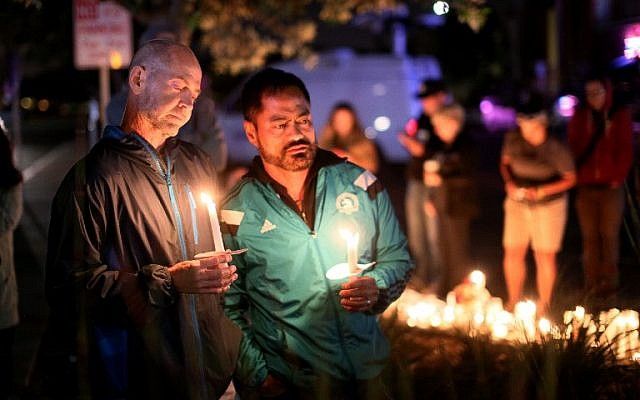 Mourners pay tribute to the victims of the Orlando shooting during a memorial service in San Diego, California on June 12, 2016.(AFP PHOTO / Sandy Huffaker)