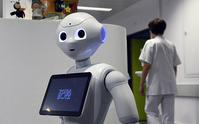 Illustrative: The robot Pepper during a press conference at the CHR Citadel hospital in Liege, Belgium,June 13, 2016. (John Thys/AFP)