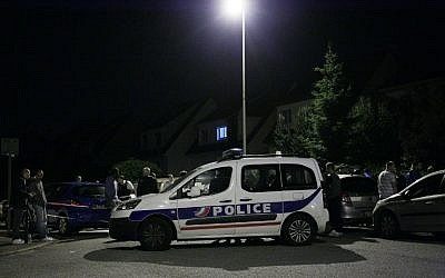 A Police vehicle blocks the road during an assault on June 14, 2016 in Magnanville, 45 kms west of Paris. A man was shot dead during a dramatic police operation in the Paris suburbs late Monday, hours after he had stabbed a police officer to death. (AFP PHOTO / MATTHIEU ALEXANDRE)