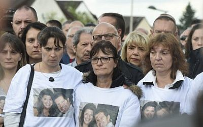 People gather outside the victims' house during a march in the Paris suburb of Magnanville, on June 16, 2016, in tribute to French policeman Jean-Baptiste Salvaing and his partner Jessica Schneider killed outside their home in Magnanville. (AFP / DOMINIQUE FAGET)