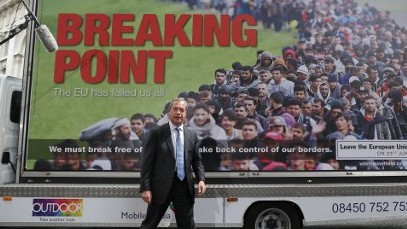 UK Independence Party Leader (UKIP) Nigel Farage in front of the 'Breaking Point' billboard on June 16, 2016. (AFP PHOTO / Daniel Leal-Olivas)