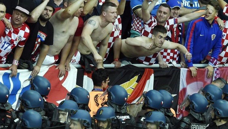 3bafe3ea64f Croatia fans react as French riot police look up at them after flares were  thrown onto