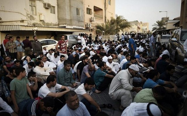 Bahraini demonstrators attend a protest against the revocation of the citizenship of top Bahraini Shiite cleric Sheikh Isa Qassim, near his house in the village of Diraz, west of the capital Manama, June 20, 2016 (AFP/Mohammed Al-Shaikh)