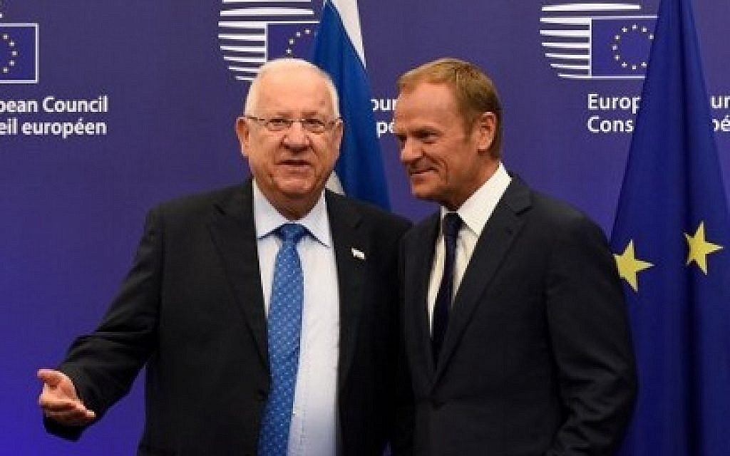 European Union President Donald Tusk, right, welcomes Israeli President President Reuven Rivlin before  their meeting at the EU headquarters in Brussels, June 21, 2016.   (AFP/JOHN THYS)