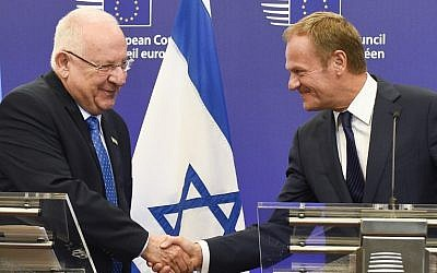 EU Council President Donald Tusk (R) and President President Reuven Rivlin (L) shake handes during a statement after their meeting at the EU headquarters in Brussels on June 21, 2016 (AFP PHOTO / JOHN THYS)