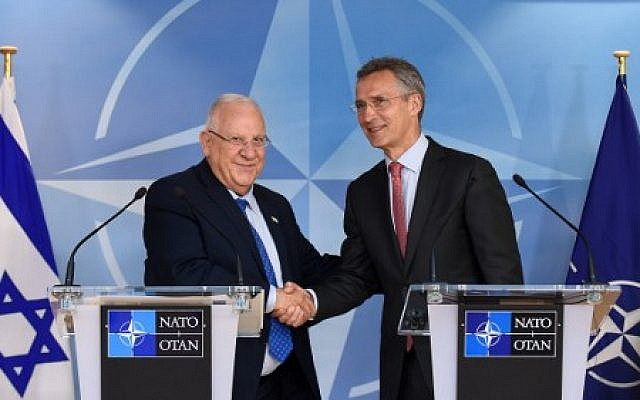 NATO Secretary-General Jens Stoltenberg, right, shakes hands with President Reuven Rivlin during a press conference after their bilateral meeting at the NATO headquarters, Brussels, June 21, 2016.  (AFP/JOHN THYS)