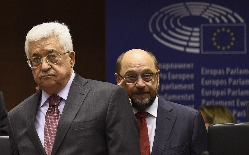 European Parliament President Martin Schulz (R) arrives with Palestinian Authority President Mahmoud Abbas (L) at the European Union Parliament in Brussels on June 23, 2016.  (AFP PHOTO / JOHN THYS)
