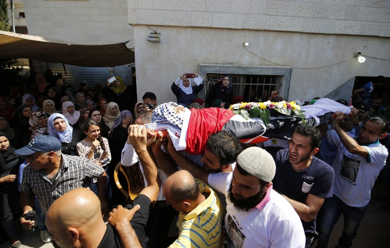 Palestinians bury teen shot 'by mistake' by IDF soldiers