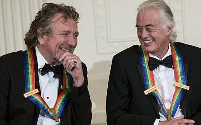 This file photo taken on December 02, 2012 shows  Led Zeppelin band members Robert Plant (L) and Jimmy Page during an event at the White House in Washington, DC, for the 2012 Kennedy Center Honorees. (AFP PHOTO / BRENDAN SMIALOWSKI)