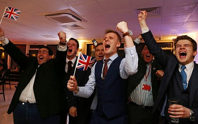 Leave EU supporters wave Union flags and cheer as the results come in at the Leave.EU referendum party at Millbank Tower in central London early in the morning of June 24, 2016.(AFP PHOTO / GEOFF CADDICK)