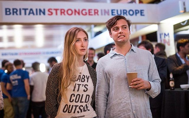 Supporters of the 'Stronger In' Campaign react as results of the EU referendum are announced at a results party at the Royal Festival Hall in London early in the morning of June 24, 2016.(AFP PHOTO / POOL / ROB STOTHARD)