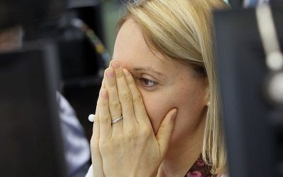 A broker reacts at the German stock exchange in Frankfurt, Germany, on June 24, 2016.(AFP PHOTO / DANIEL ROLAND)