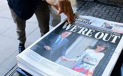 A man takes a copy of the London Evening Standard with the front page reporting the resignation of British Prime Minister David Cameron and the vote to leave the EU in a referendum, in London on June 24, 2016. (Leon Neal/AFP)