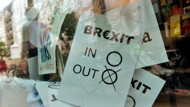 "A poster featuring a Brexit vote ballot with ""out"" tagged is on display at a book shop window in Berlin on June 24, 2016. (John MacDougall/AFP)"