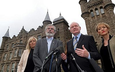 Sinn Fein leader Gerry Adams (L) and Sinn Fein politician and Northern Ireland's Deputy First Minister, Martin Mcguinness (2R) speak during a press conference outside Stormont Castle in Belfast, Northern Ireland on June 24, 2016, after the United Kingdom's June 23 referendum in which voters chose to leave the European Union. (AFP Photo/Paul Faith)