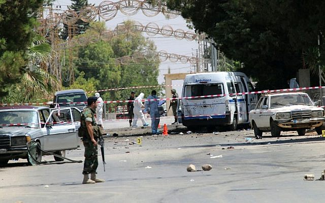 Lebanese security forces secure the site of multiple suicide bombings which took place early on June 27, 2016 in the predominantly Christian village of Al-Qaa, in eastern Lebanon near the border with Syria. (AFP/ STRINGER)