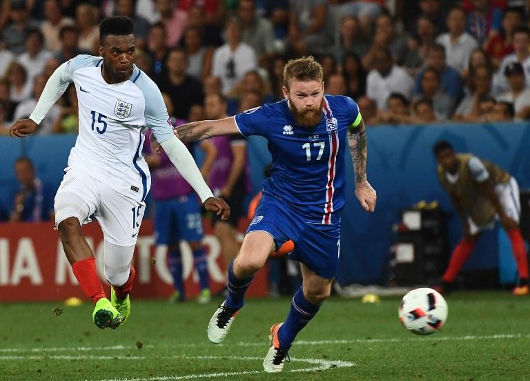 Iceland s midfielder Aron Gunnarsson (R) and England s forward Daniel  Sturridge vie for the ball 6683639f9