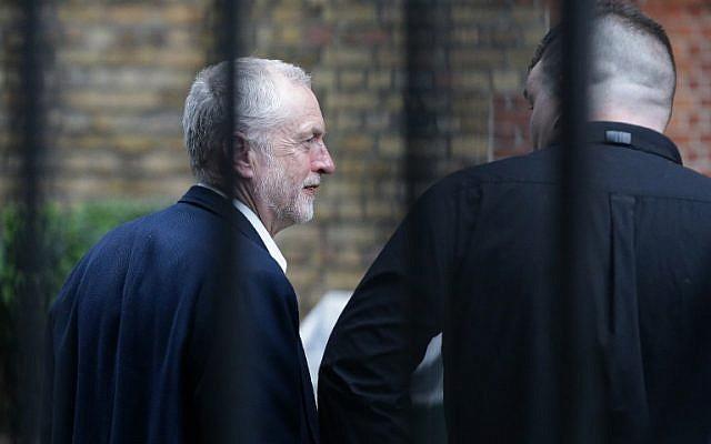British opposition Labour Party Leader Jeremy Corbyn (L) walks near Portcullis House in central London on June 28, 2016.(AFP/Daniel Leal-Olivas)