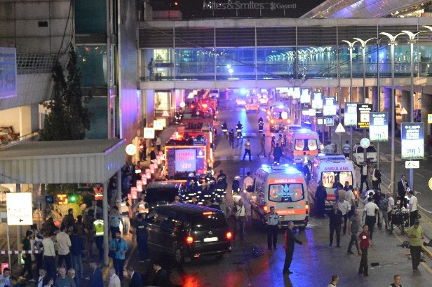 This picture obtained from the Ilhas News Agency shows ambulances and police setting up a perimeter after two explosions followed by gunfire hit Ataturk Airport in Istanbul, on June 28, 2016. (AFP PHOTO/ILHAS NEWS AGENCY)