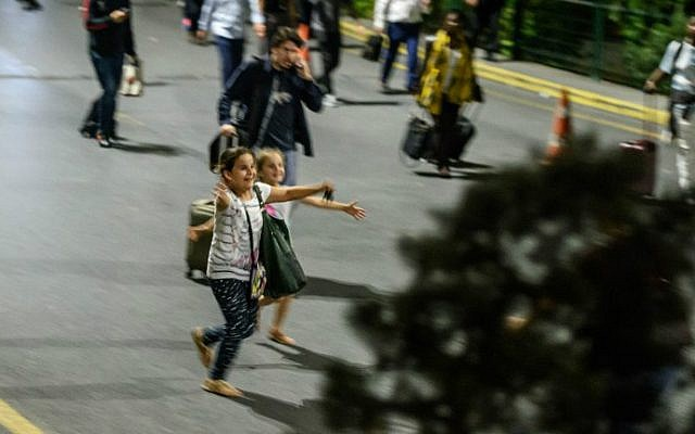 Children run to their relatives as they leave Ataturk Airport on June 28, 2016 in Istanbul after two explosions followed by gunfire hit Turkey's biggest airport. (Ozan Kose/AFP)