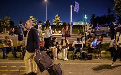 Passengers wait at Ataturk airport`s main entrance in Istanbul, on June 28, 2016, after two explosions followed by gunfire hit Turkey's largest airport, killing at least  36. (AFP / OZAN KOSE)
