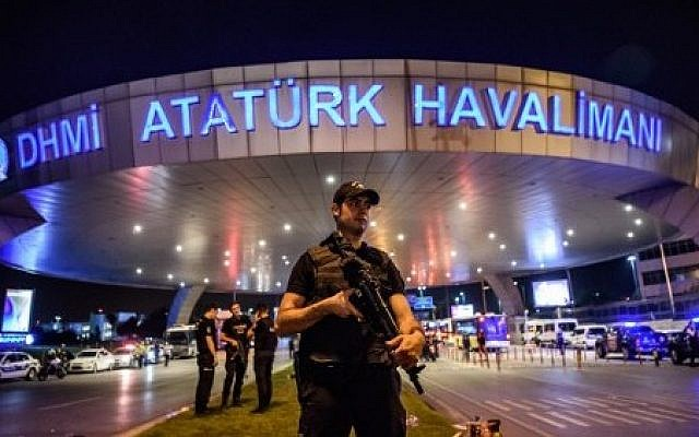 A Turkish riot police officer patrols Ataturk airport`s main entrance in Istanbul, on June 28, 2016, after explosions followed by gunfire hit Turkey's largest airport. (AFP/ OZAN KOSE)