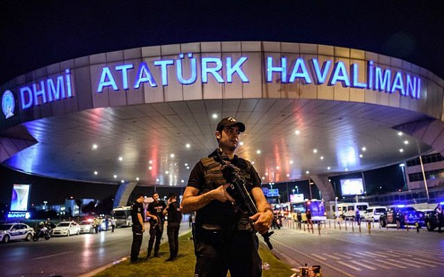 A Turkish riot police officer patrols Ataturk Airport's main entrance in Istanbul, on June 28, 2016. (Ozan Kose/AFP)
