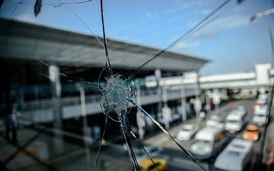 Bullet impacts are pictured on a window at Ataturk airport's International airport on June 29, 2016, a day after a suicide bombing and gun attack targeted Istanbul's airport, killing at least 41people. (AFP/Ozan Kose)