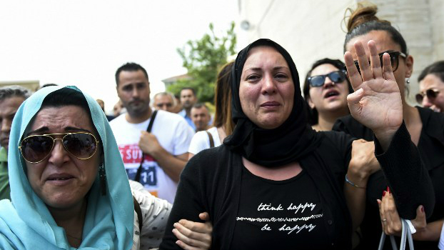 The daughter, right, of Siddik Turgan, a man who was killed in the June 28, 2016 Ataturk Airport attack, reacts as her father's coffin is carried during his funeral ceremony on June 29, 2016 in Istanbul. (Bulent Kilic/AFP)