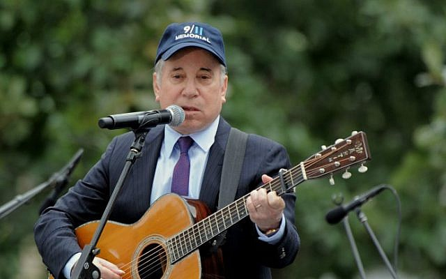 "This file photo taken on September 11, 2011 shows singer Paul Simon as he performs ""Sounds of Silence"" during the 10th Anniversary commemoration of the September 11, 2001 attacks at the lower Manhattan site of the World Trade Center in New York. (Stan Honda/AFP)"