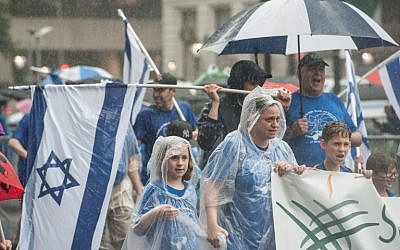 People participate in the Celebrate Israel Parade in the rain on June 5, 2016 in New York City (Stephanie Keith/Getty Images/AFP)