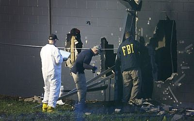 FBI agents investigate near the damaged rear wall of the Pulse Nightclub on June 12, 2016 in Orlando, Florida. (Joe Raedle/Getty Images/AFP)