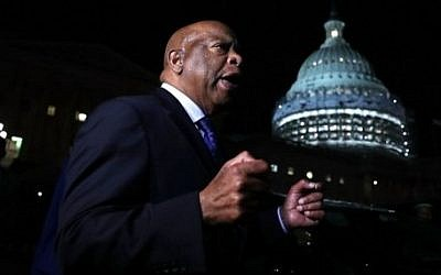 U.S. Rep. John Lewis (D-GA) speaks to gun control activists who gather outside the Capitol after House Republicans have forced votes as House Democrats stages a sit-in on the House floor June 22, 2016 on Capitol Hill in Washington, DC. (Alex Wong/Getty Images/AFP)