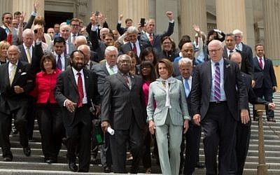 House members led by Minority Leader Nancy Pelosi (D-CA) and James Clyburn (D-SC), walk down the East Front of the U.S. Capitol building to speak with supporters on June 23, 2016. (Allison Shelley/Getty Images/AFP)