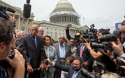 Rep. John Lewis (D-GA), left, Minority Leader Nancy Pelosi (D-CA), center, and Charles Rangel, (D-NY), right, speak with supporters outside the U.S. Capitol building June 23, 2016. (Allison Shelley/Getty Images/AFP)