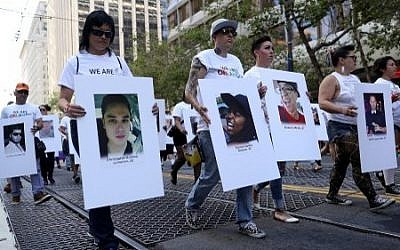 A group carries photos of victims of the Orlando nightclub shooting during the 2016 San Francisco Pride Parade on June 26, 2016 in San Francisco, California. ( Justin Sullivan/Getty Images/AFP)