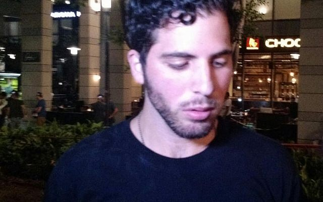 The bartender at the Max Brenner restaurant at the Sarona compound recalls the shooting attack on June 8, 2016 (Judah Ari Gross/Times of Israel)