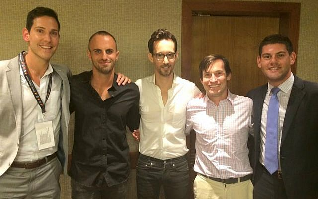 Josh Mann (right) poses with fellow JFNA LGBT mission participants Kyle Levine and David Rak, along with Israeli singer Ivri Lider (center) and Israeli media personality Aviad Kisos (second from left). Tel Aviv Hilton, May 31, 2016. (Renee Ghert-Zand/Times of Israel)