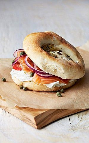 Illustrative: A bialy with lox, cream cheese, onions, and capers. (Courtesy Kossar's Bagels and Bialys)
